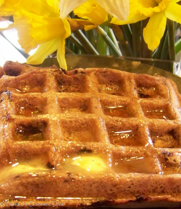 close up of a gluten free vgean waffles with melted butter