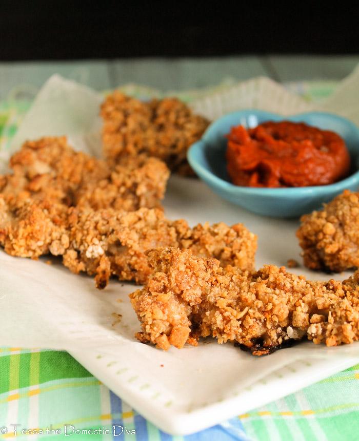 gluten free oven fried chicken arranged on white plate