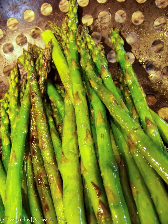 close up of grilled asparagus in a grill basket from overhead