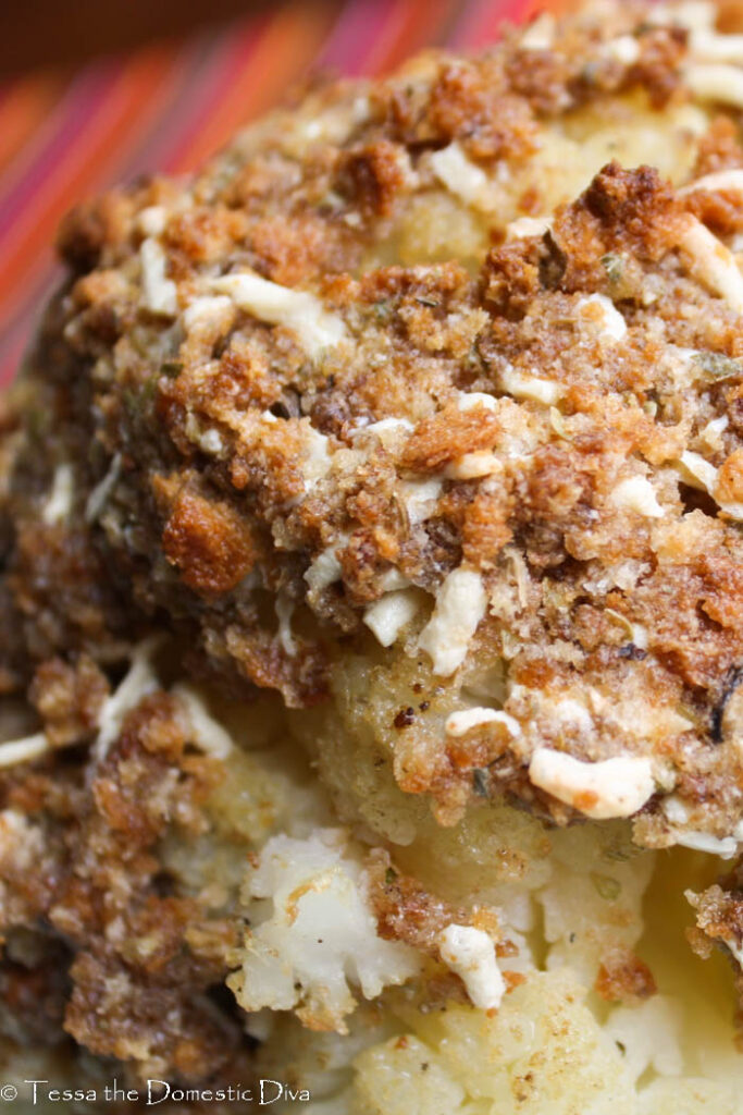 close up of a breaded roasted whole cauliflower head.
