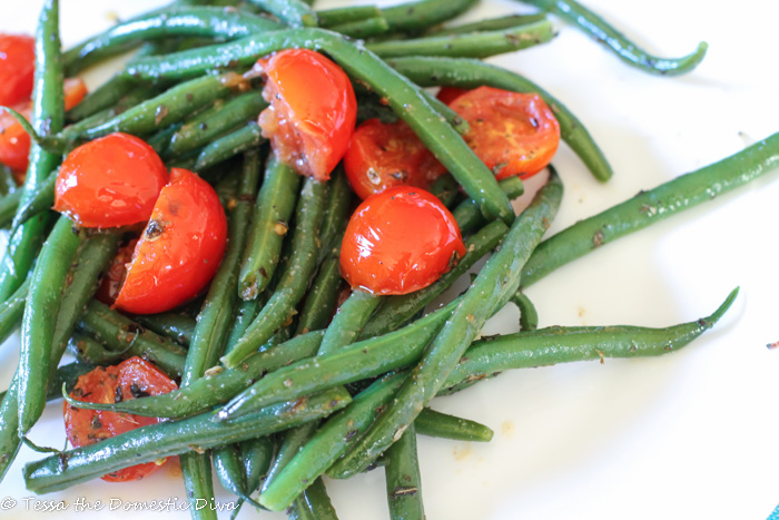 halved cherry tomatoes with fres, tender green beans in a butter and basil sauce