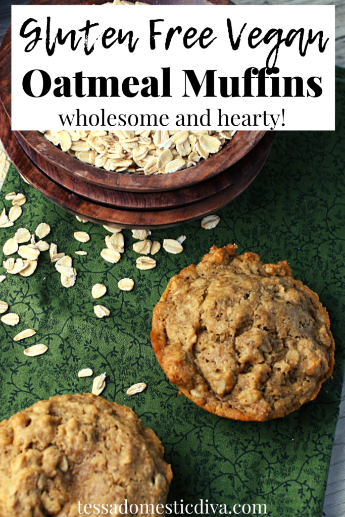 pinterest ready oatmeal studded muffins from overhead with a scattering of rolled oats on a green cloth