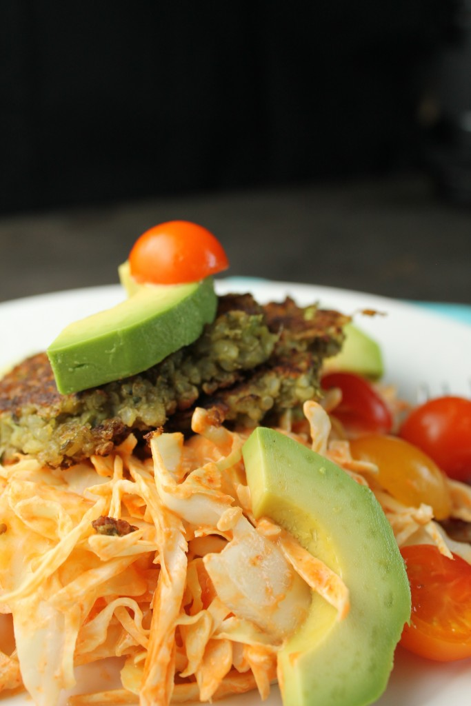 a spicy orange slaw topped with a vegetarian mung bean falafel with an avocado slice
