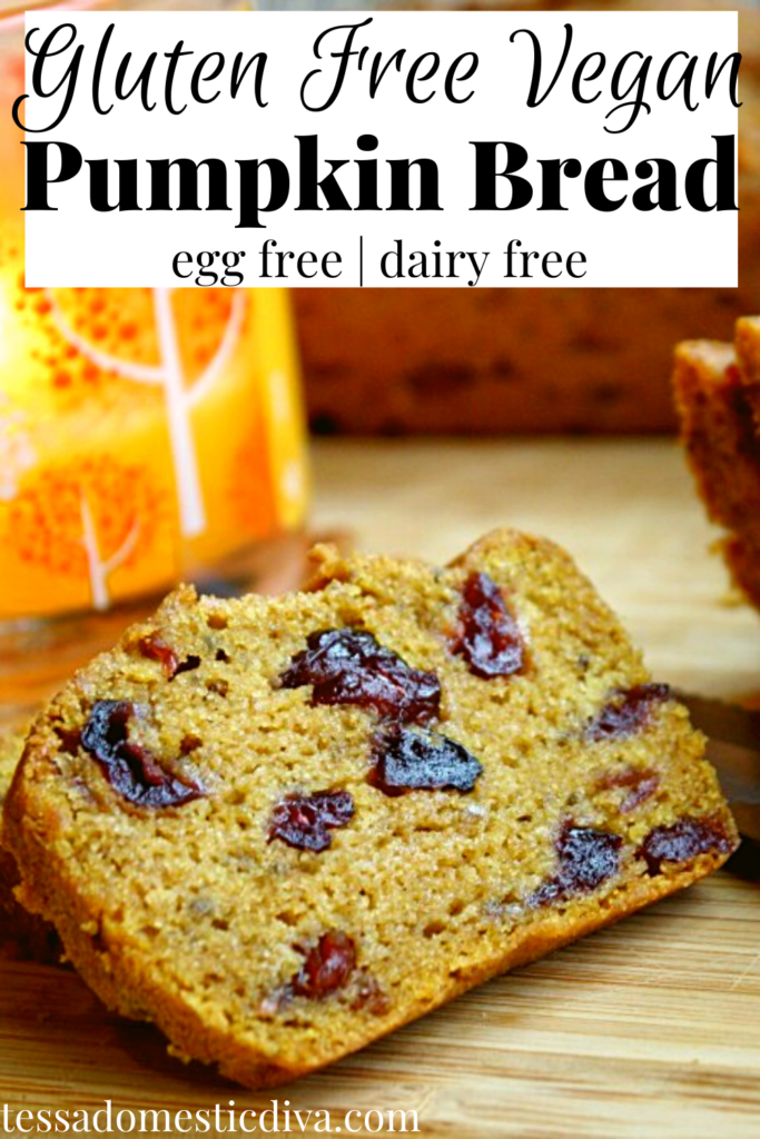 pinterest ready of an orange hued pumpkin loaf studded with dried cranberries, sliced on a bamboo cutting board