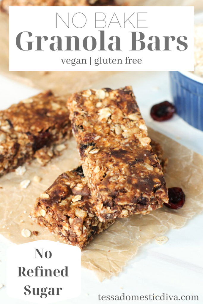 pinterest ready homemade granola bars with chocolate chips on natural parchment paper.