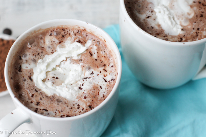 birds eye view of two white mugs with hot chocolate and melting cream