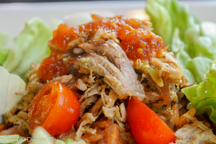 close up eye level pulled pork with cherry tomatoes and fresh lettuce