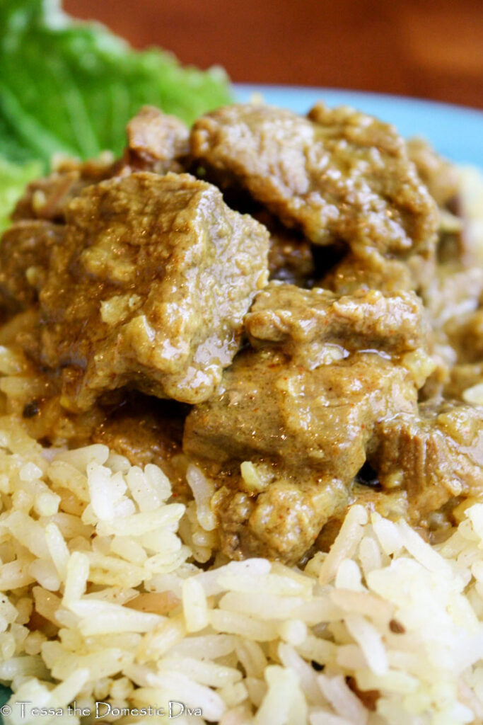tender beef cubes in a vindaloo sauce served atop a  bed of brown rice