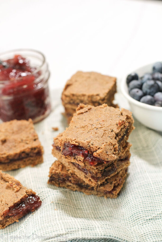 stack of three wholegrain fruit filled cereal bars with berry preserves