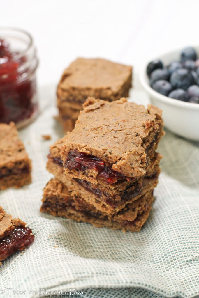 gluten free cereal bars with fruit filling on a linen cloth