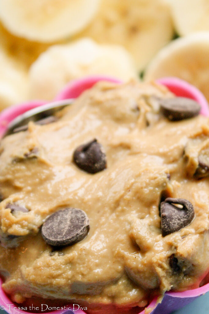 creamy peanut butter dip with chocolate chips and fresh banana slices