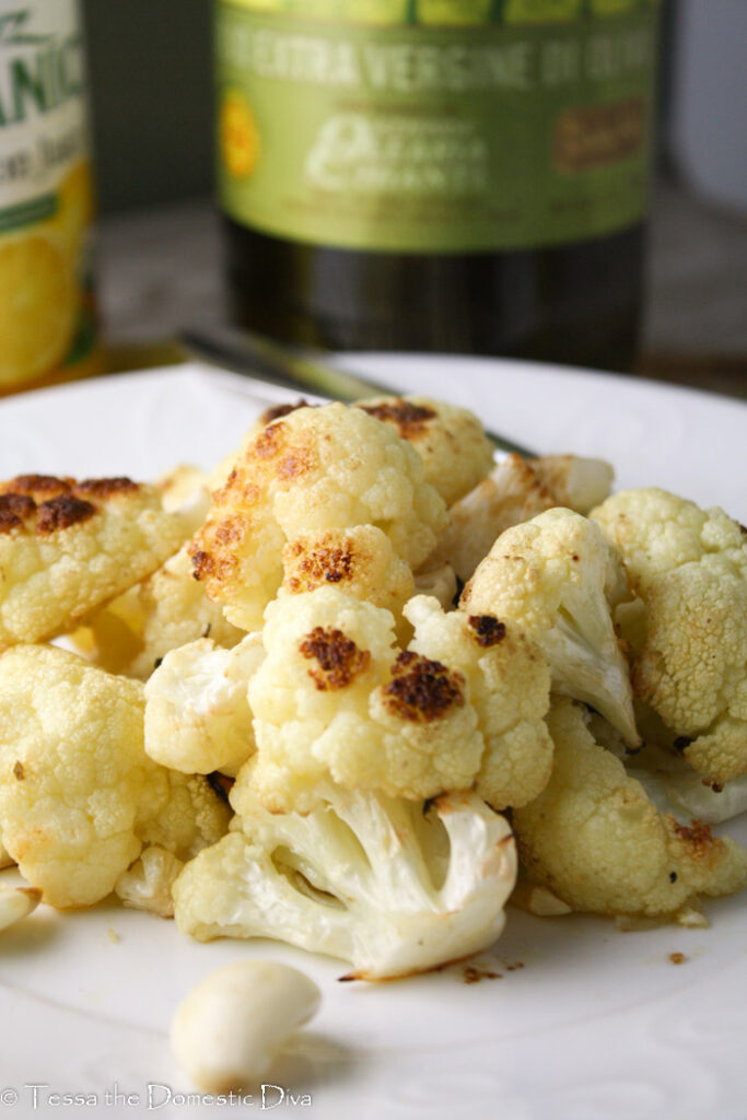 a white plate with roasted cauliflower.