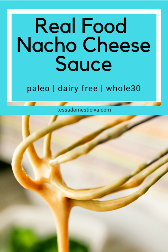 optimized for pinterest close up of a whisk dripping with a orange cheese sauce