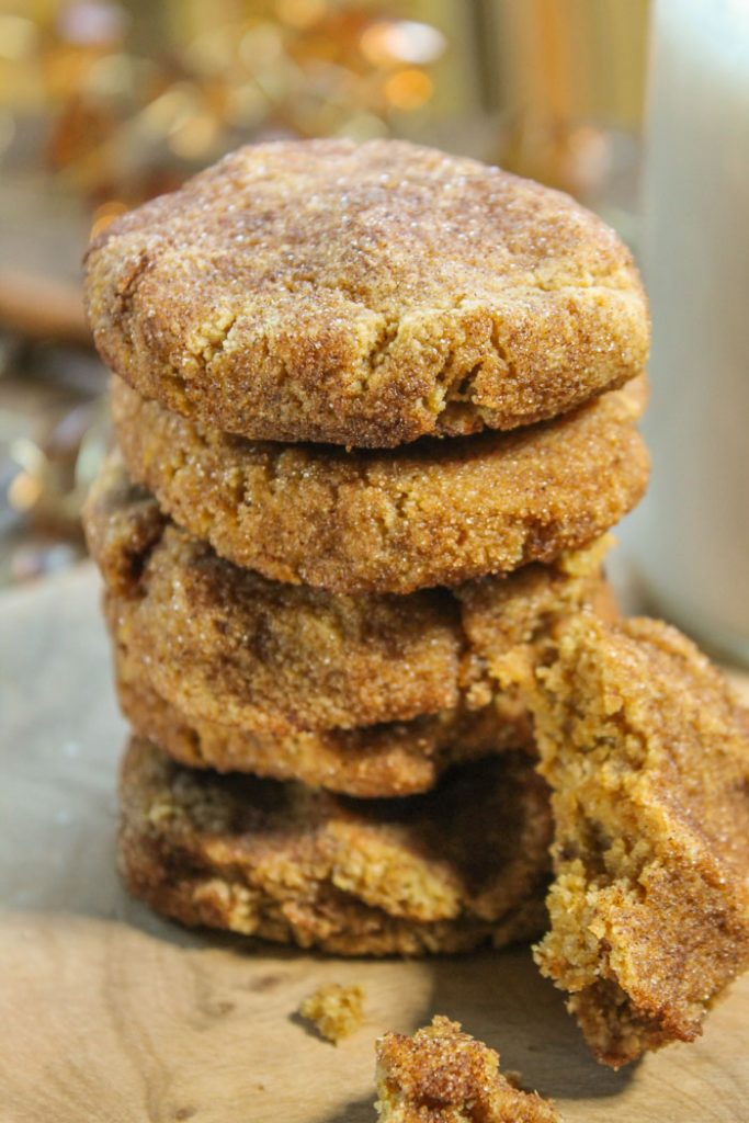 a close up of five stacked pumpkin cookies with a coating of cinnamon and sugar