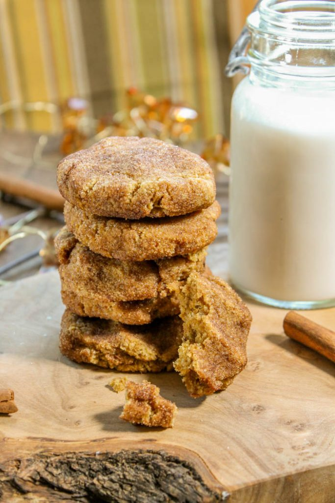 stack of five pumpkin snickerdoodles cookies with a vintage milk container