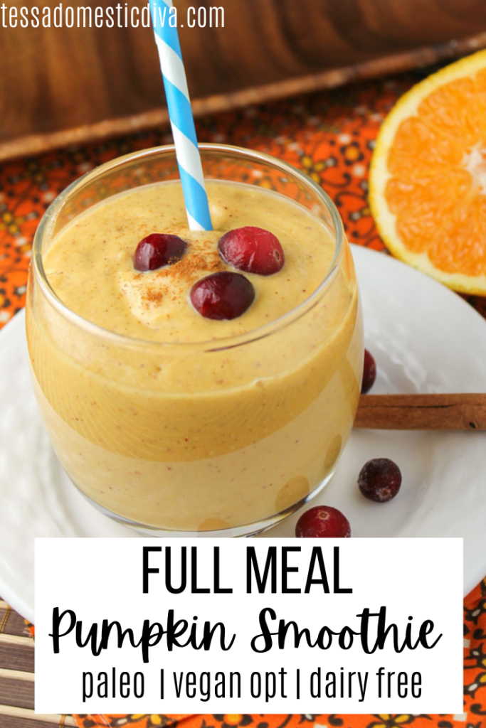 pinterest ready glass of pumpkin smoothie with fresh cranberry and orange and cinnamon