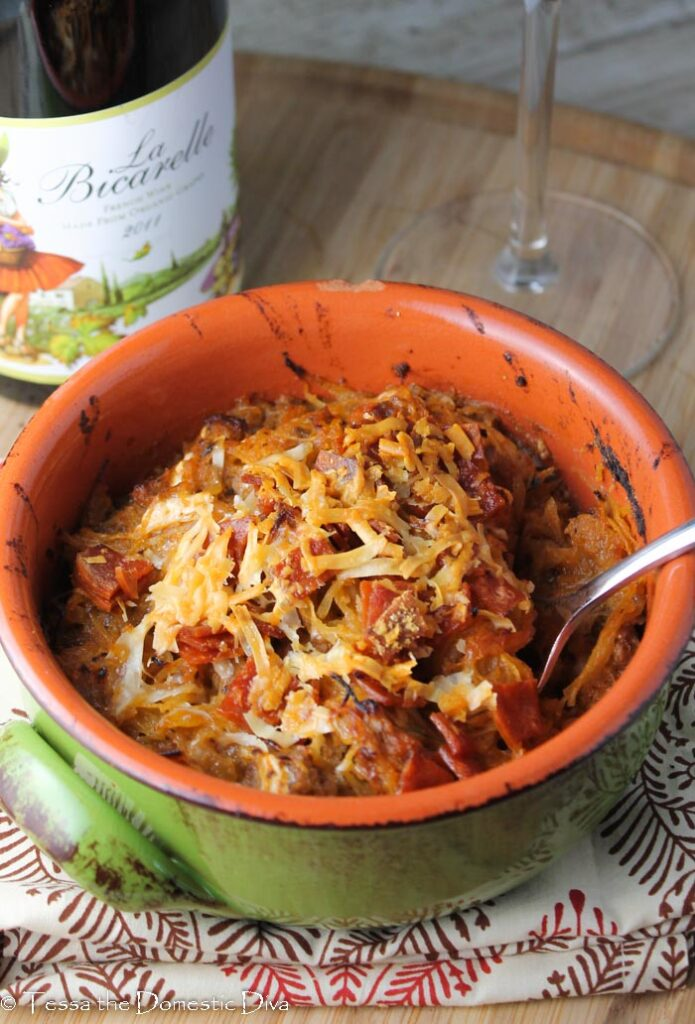 green terracotta bowl filled with paleo pizza casserole topped with golden cheese