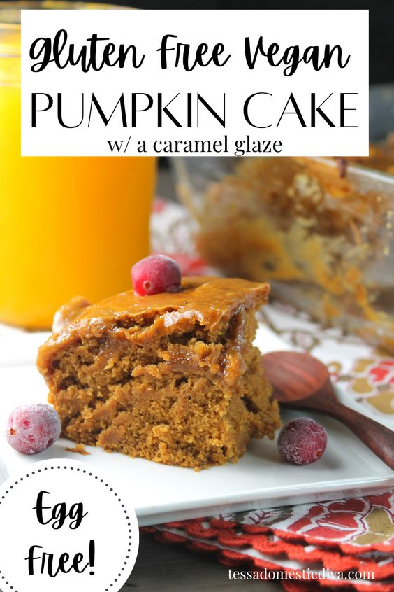 pinterest ready slice of pumpkin cake with a shiny caramel glaze and topped with fresh cranberry and a jar of fresh pumpkin in background