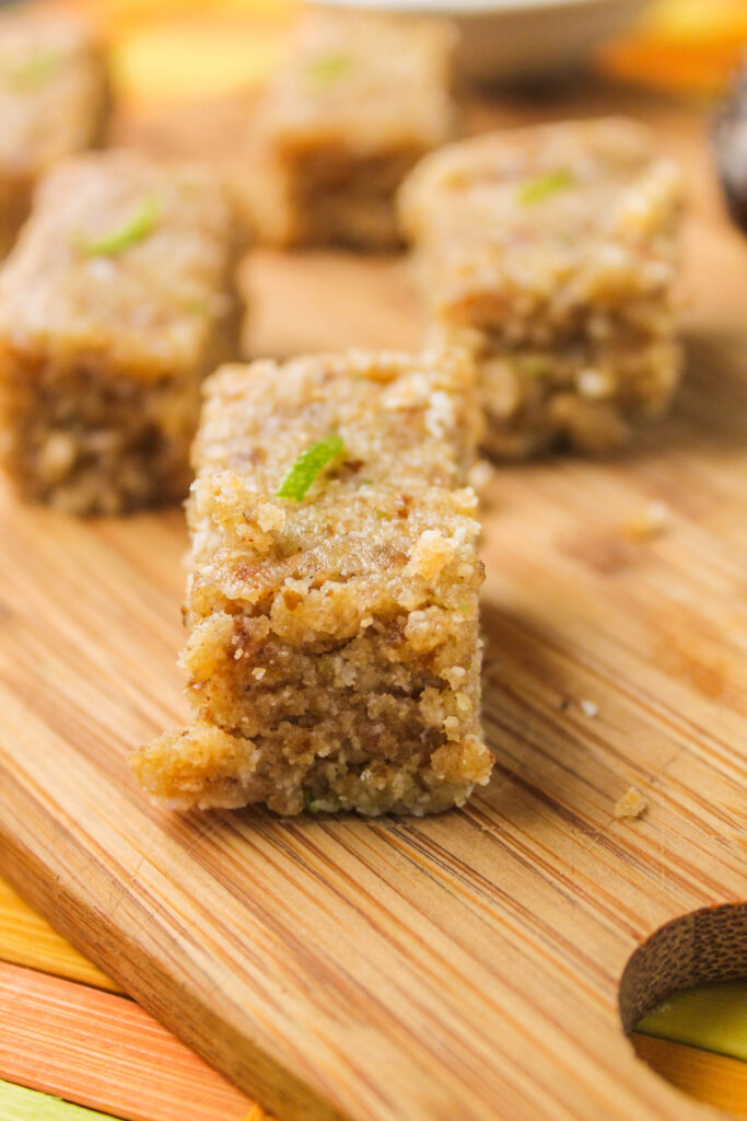 no bake rectangle shaped energy bars of lime, coconut, and hemp bar close up.