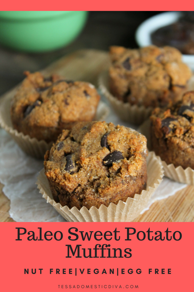 optimized for pinterest 4 chocolate studded sweet potato mini muffins in natural paper liners arranged on a wooden cutting board