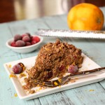 a slice of struesel topped coffee cake with cranberries and orange