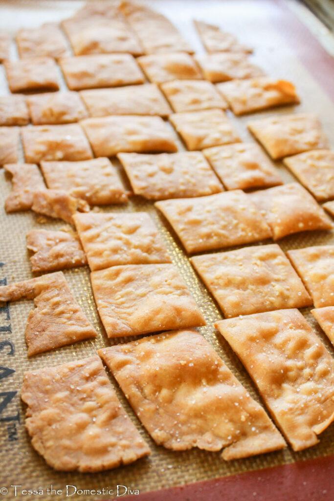 crispy bubbling homemade crackers on a baking sheet