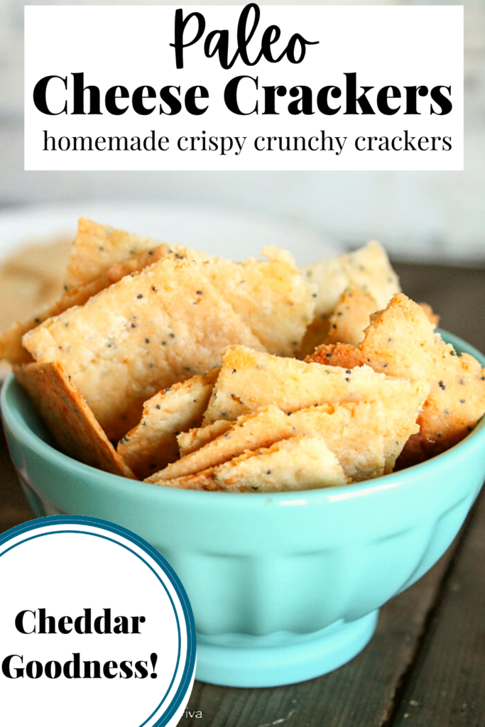 pinterest ready bowl of cheese filled crackers on a dark wood surface