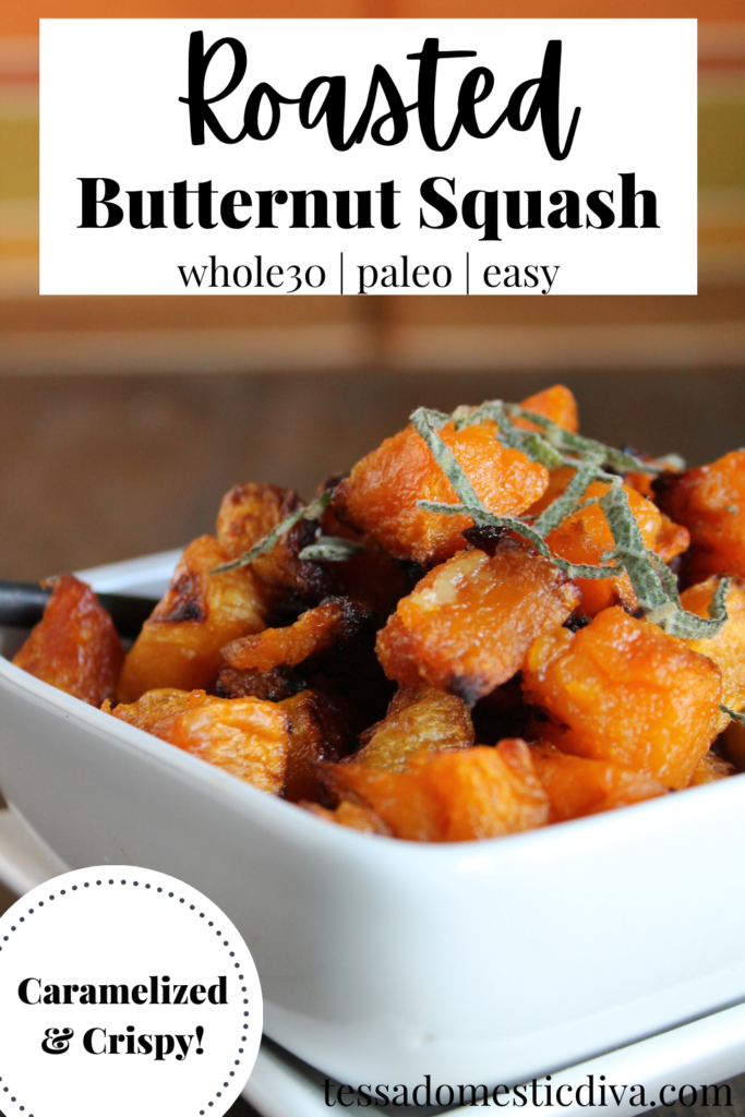 pinterest ready caramelized cubes of roasted butternut squash with a chiffonade of sage in white bowl