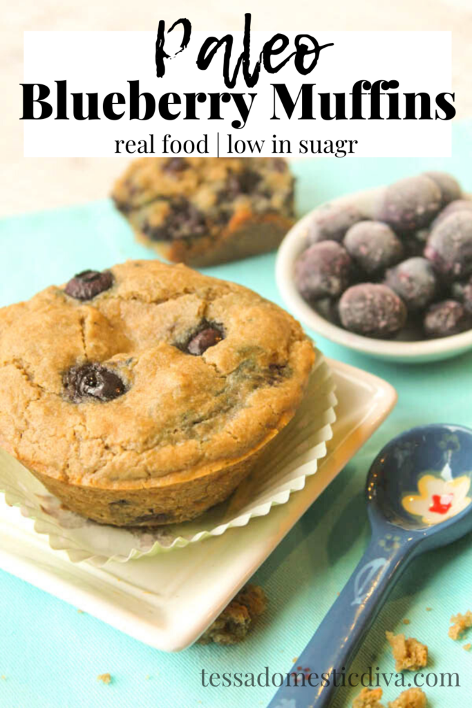 pinterest ready paleo blueberry muffins on a white square plate with ahand painted blue measuring spoon