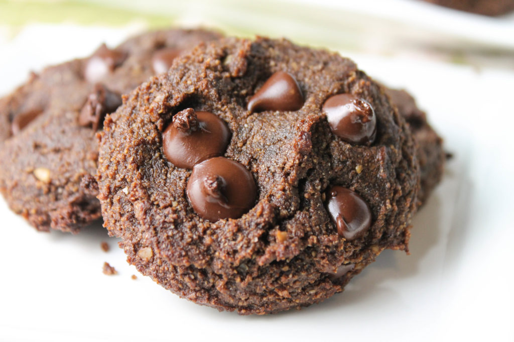 close up horizontal of double chocolate cookie on a white plate