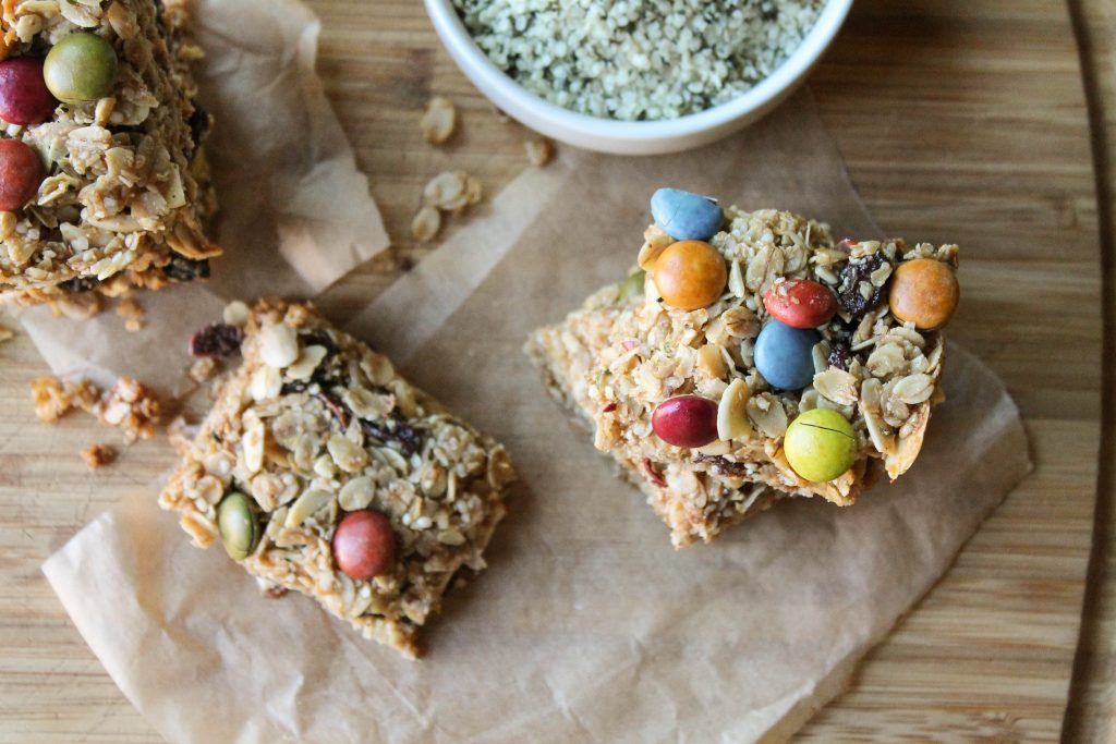 homemade granola bars with dye free m & m's from overhead on parchment