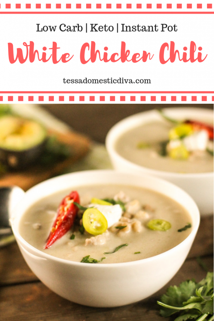 optimized for pinterest vertical image of two white bowls on a dark wooden surface filled with a creamy white soup garnished with avocado, sour cream, and sliced jalapenos
