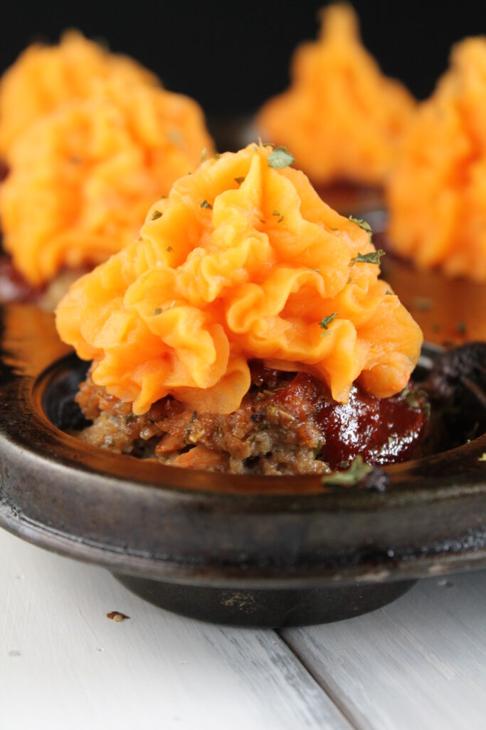 eye level of a cupcake shaped meatloaf with sweet potato 'frosting.'