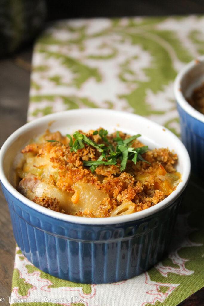 a single navu blue and white ramekin filled with a dairy tuna noodle casserole