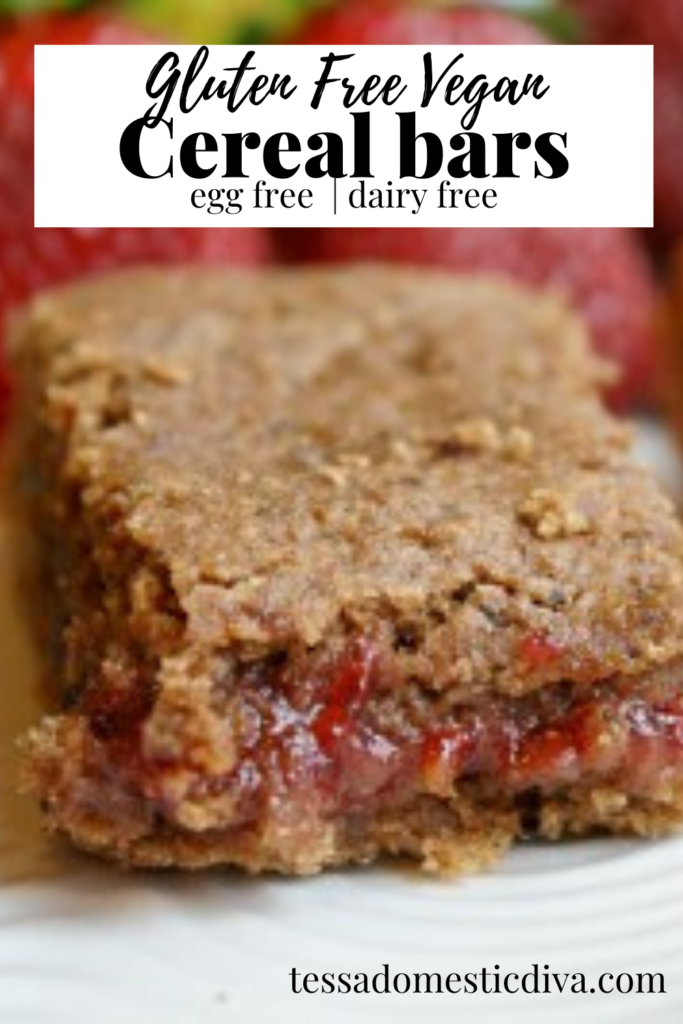 pinterest ready close up of a strawberry filled homemade cereal bar cut up on a white plate