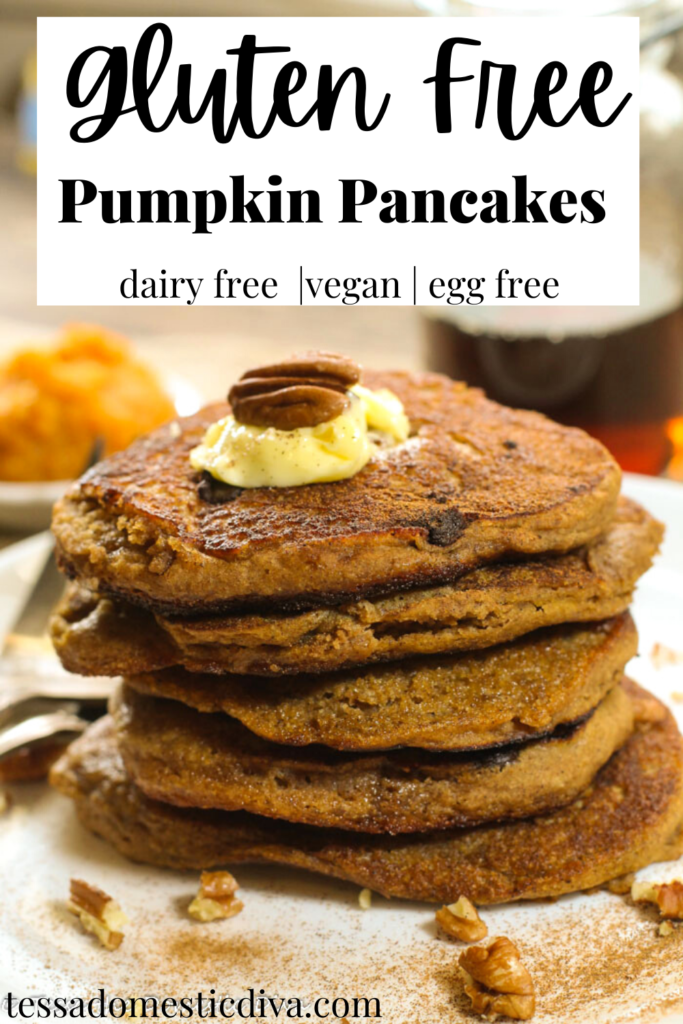 pinterest ready stack of pumpkin pancakes on a white plate with pecan and butter garnish