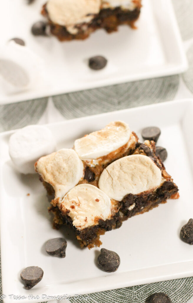 two squares of blondies with marshmallows