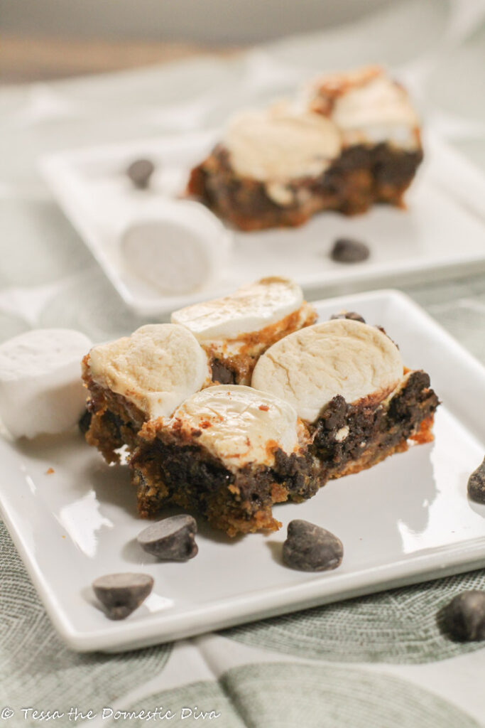 marshmallow topped chocolate chip blondies on a square white plate