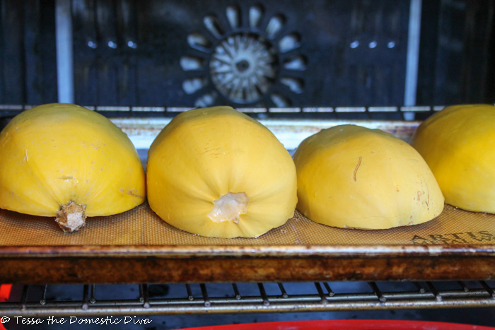 4 spaghetti squash halves on a cookie sheet inside the oven