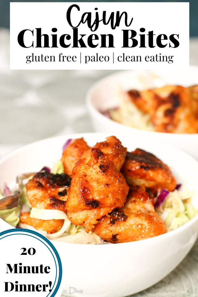 pinterest ready white bowl filled with a cajun slaw and crispy orange hued cajun chicken breast bites